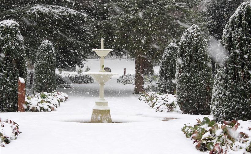 fountain snow scene in frodsham castle park gardens winter 2014