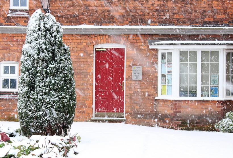 red door main street snow scene in winter 2014 frodsham