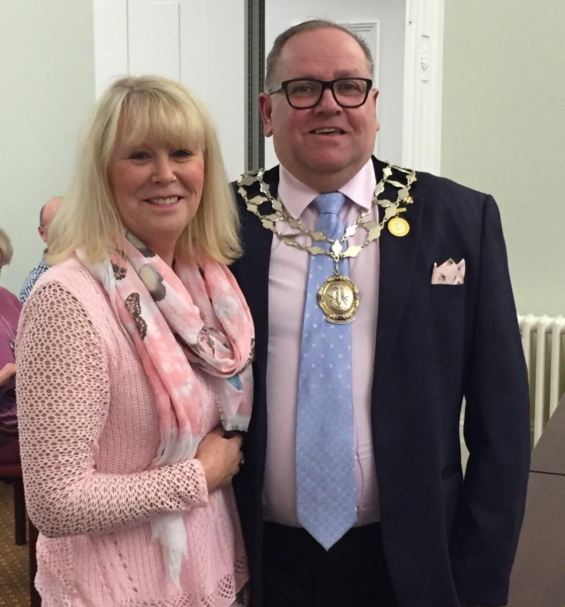 New mayor of Frodsham cllr Mallie Poulton is handed the chains by outgoing mayor cllr Fran Sutton
