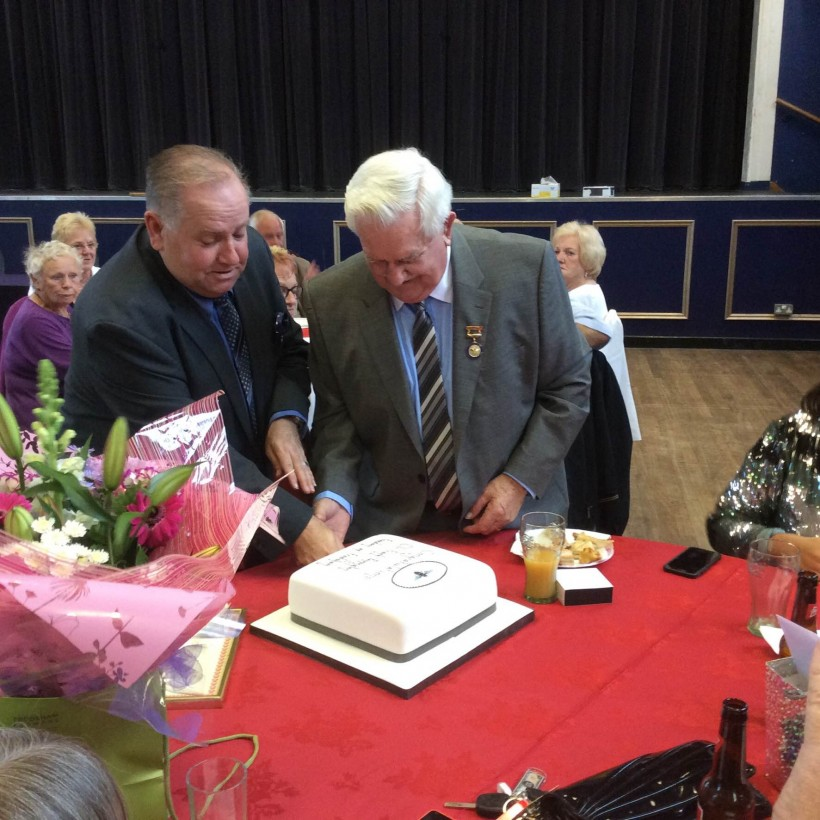 Mallie Poulton and Cllr Frank Pennington cutting cake