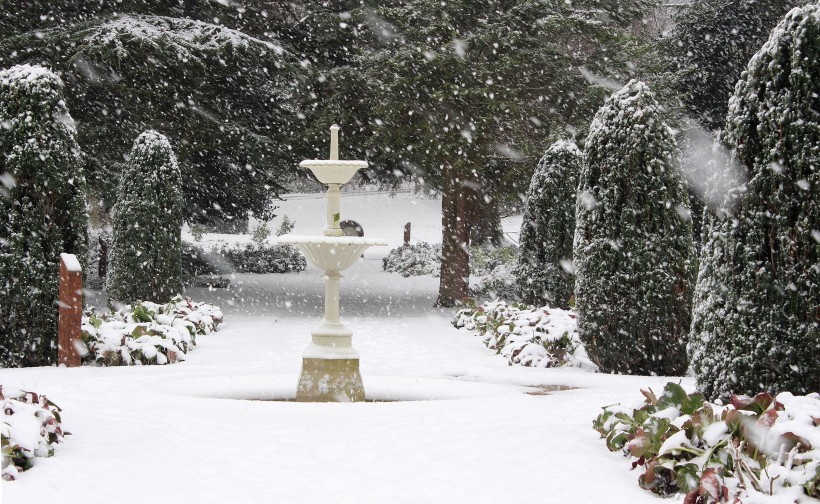 fountain snow scene in frodsham castle park gardens winter 2014