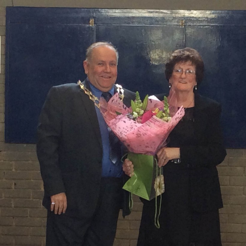 Mallie Poulton presenting Mrs Pennington with flowers in Frodsham