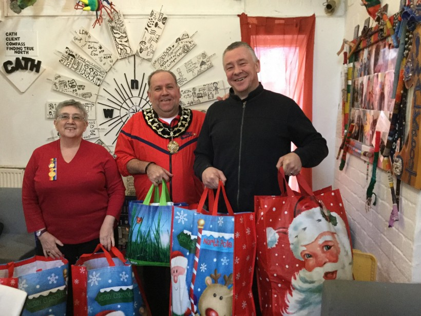 Handing over gifts for the homeless at Christmas