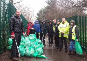 Photo of volunteers with rubbish collected