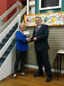 Photo of Mayor presenting cheque to FYA