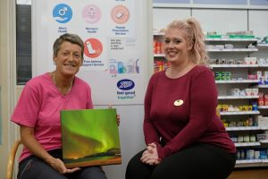 Jackie with Boots Frodsham Manager Donna and her prize canvas print