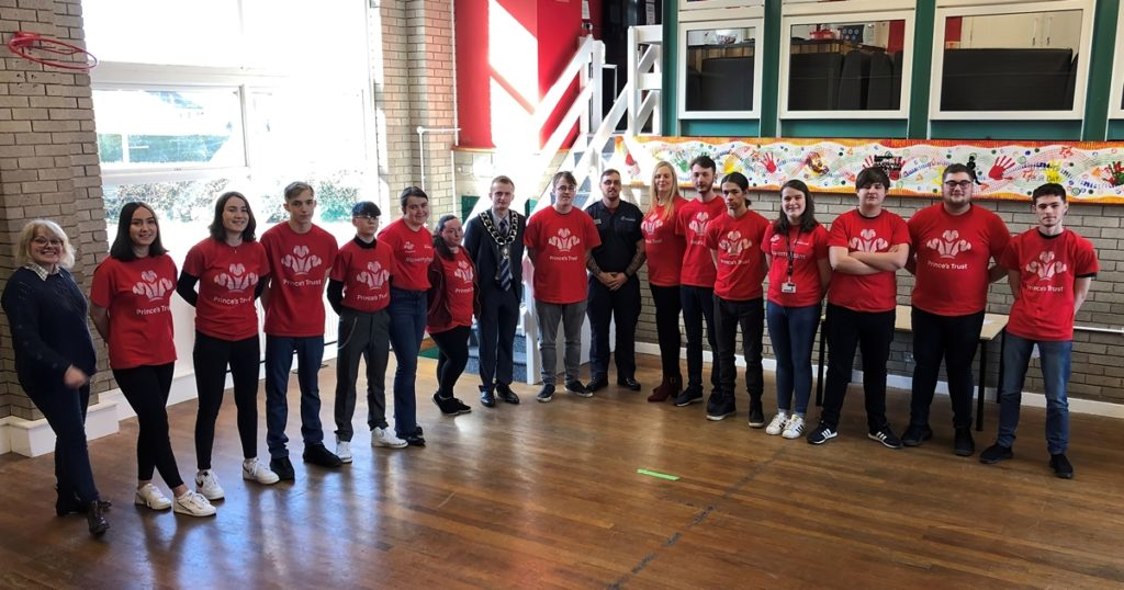 Group photo of volunteers in red Princes Trust tee-shirts, together with the Mayor and Chesire West & Chester councillor Lynn Riley