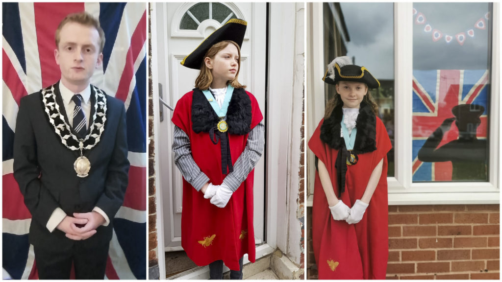 Mayor Cllr Liam Jones and Junior Mayors Eva and Robyn pay their respects in the two minutes silence.