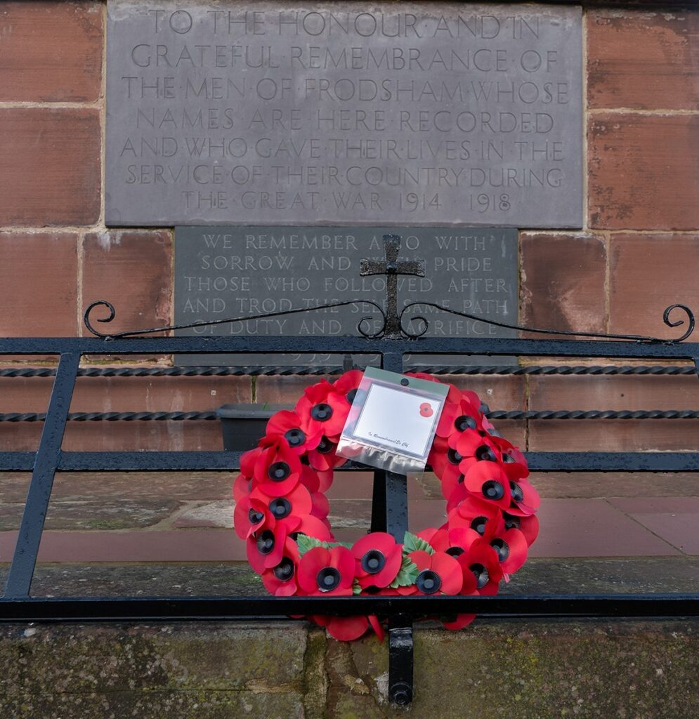 Photo of a poppy wreath laid at the base of the Memorial on Overton Hill